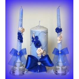 Свадебные свечи с синими атласными лентами  www.crystalmary.ru