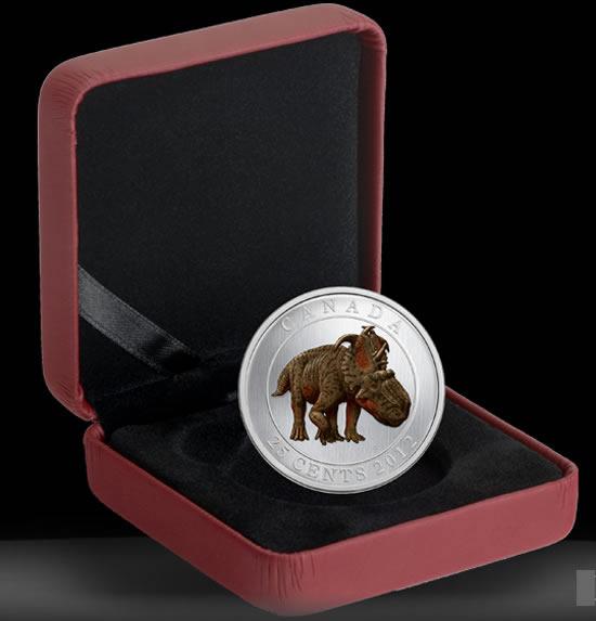 В Канаде выпущены светящиеся в темноте монеты с изображением динозавра и королевы